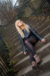 blonde woman on stairs