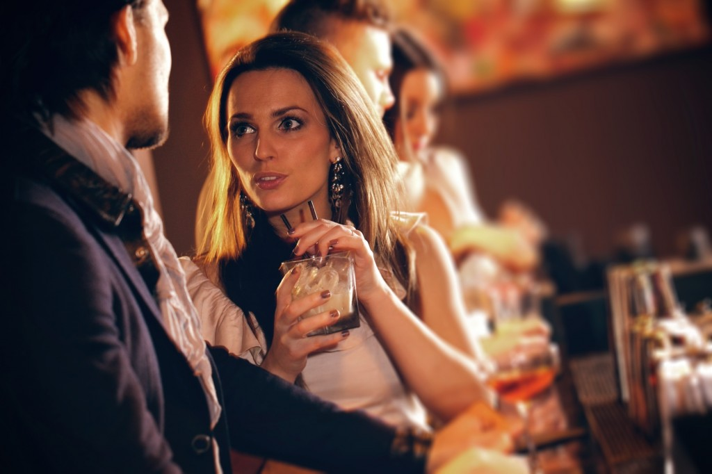 Young Woman in Conversation with a Guy at the Bar