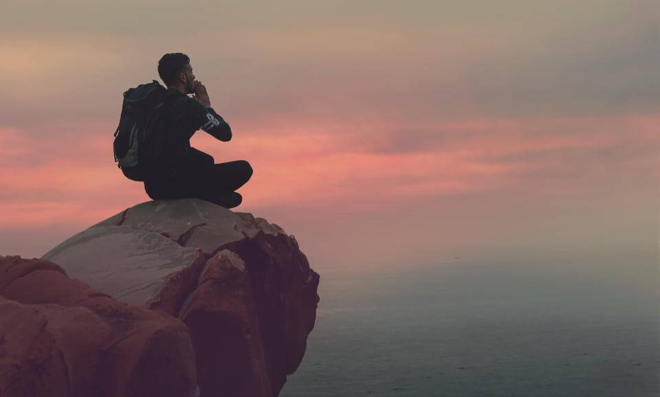 thinking on a cliff