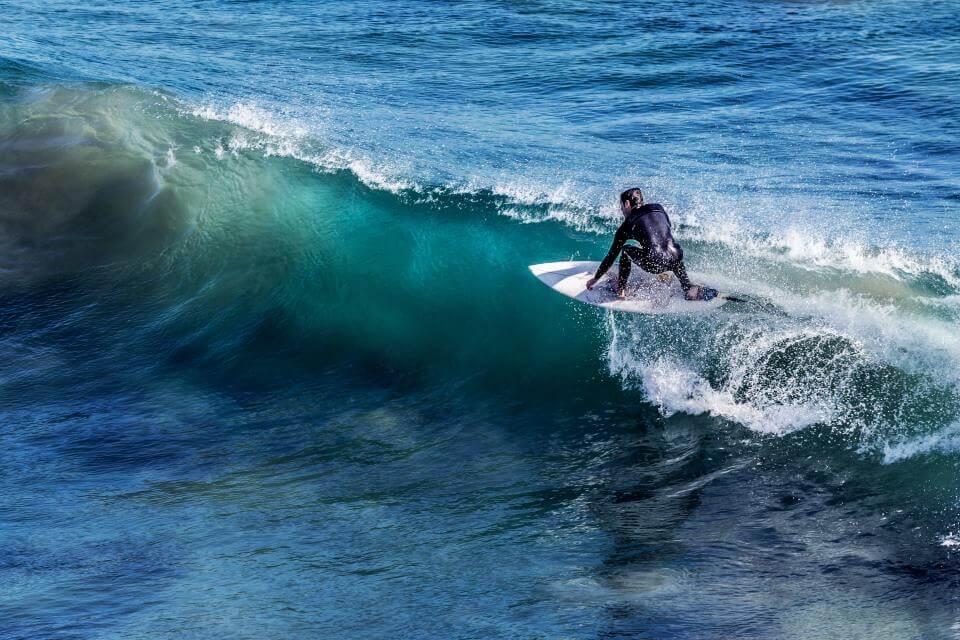 happy surfing man